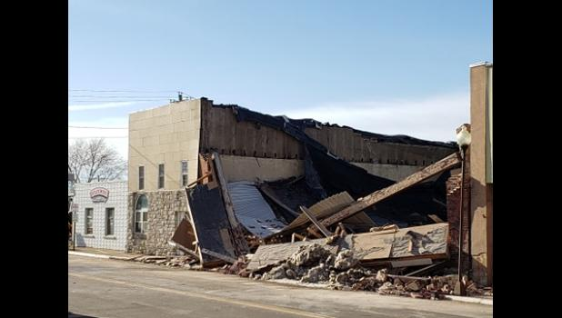 The former Curtis Department store building collapsed without warning this morning.