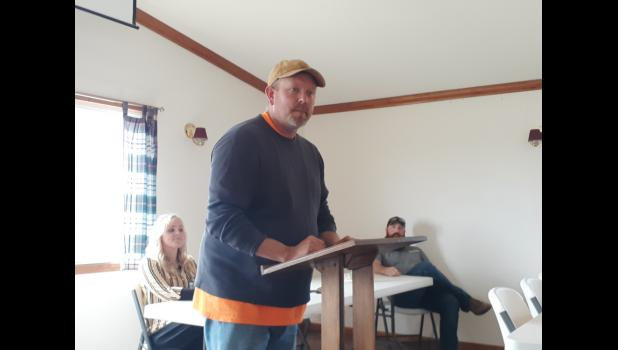 """Candidate Adam Webb addresses the Chamber. He focused on trade schools and vocational education. In response to a question about STEM education, he said, """"I'm all for it. I was always a parent not to walk up and solve a problem for him. Give him time to figure a way out."""" (photo credit: Amanda Mendez)"""