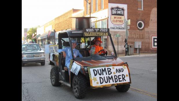 "Valedictorian Bryce Friga, in orange, shares a ""Dumb and Dumber""-themed UTV with Brody McKee. (photo credit: Amanda Mendez)"