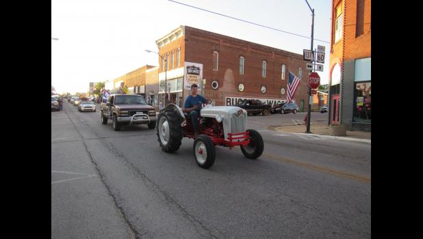Kole Wood drives the 956 Ford 600 tractor he refinished for his senior project. (photo credit: Amanda Mendez)