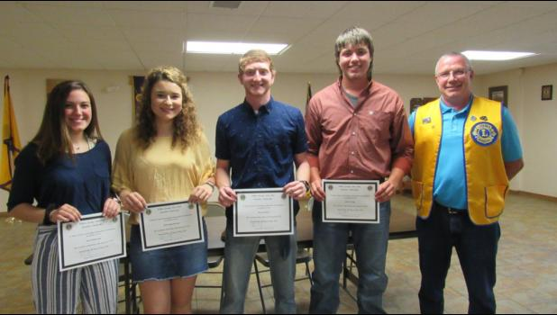 Left to right: Zoe Kimbrough, Emily Scarborough, Brady Walton, Bryce Friga, and Lion Dean Aye. (photo credit: Amanda Mendez)
